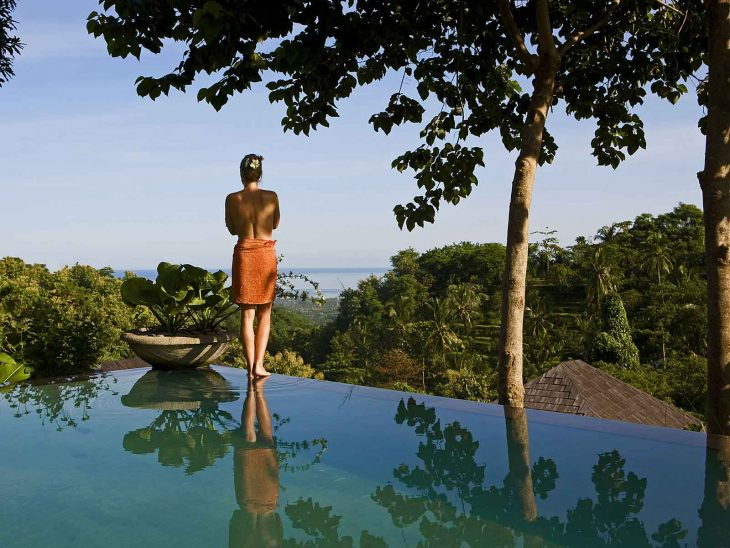 Woman by one of the villa pools at The Damai, northern Bali´s best luxury retreat.