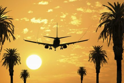 iStock_000002130357Large-airplane-in-sunset