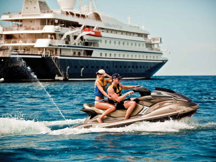 Taking the jet ski for a spin while cruising with SeaDream.