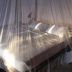 Large beds with mosquito net at Sandoway Resort in Ngapali Beach, Myanmar.