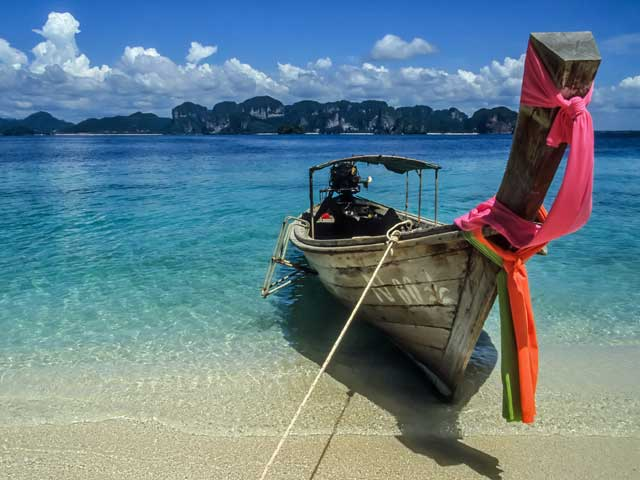 A long tail boat on one of Phukets many beaches.