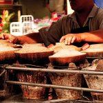 Food hawker in China Town, Kuala Lumpur, Malaysia.