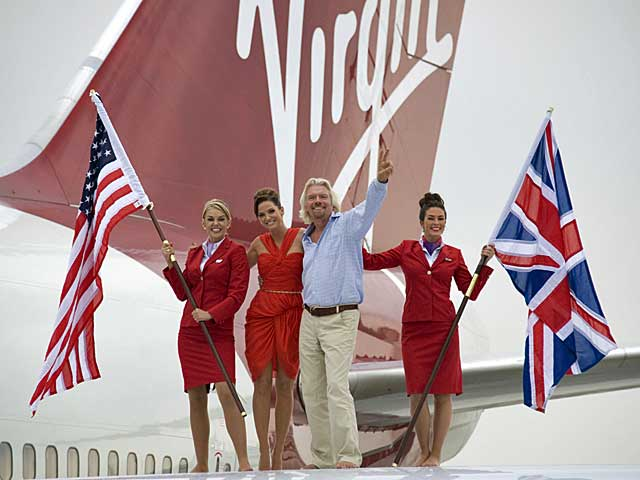 Sir Richard Branson celebrating 25 years on the London-Miami route with Sarah Harding