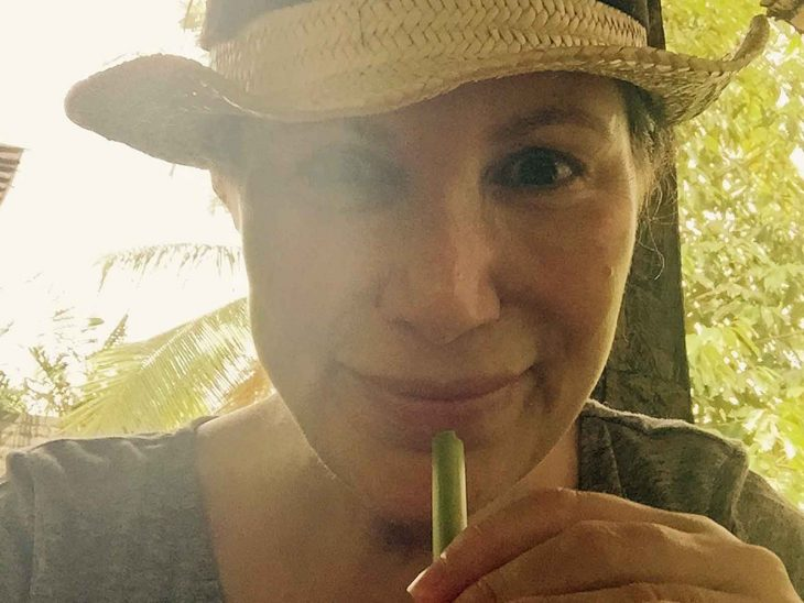 Karin drinking coconut water and feeling good in Ubud, Bali.