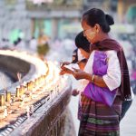 Women saving prayers at Schwedagon Pagoda in Yangon, Myanmar (aka Burma)