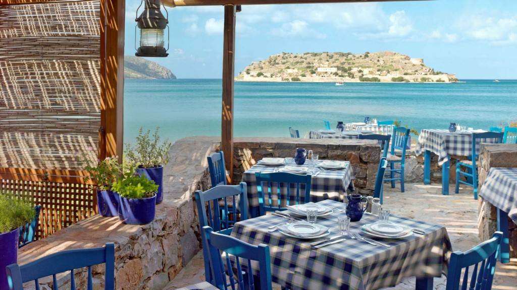 A table with a view at Blue Door Restaurant at Blue Palace Resort & Spa.