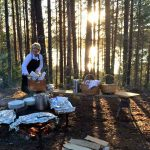 Chef preparing an outdoor lunch at Camp Sävenfors, Sweden.