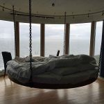 The bed is suspended from the ceiling at The Falcon´s Nest at Kullaberg.