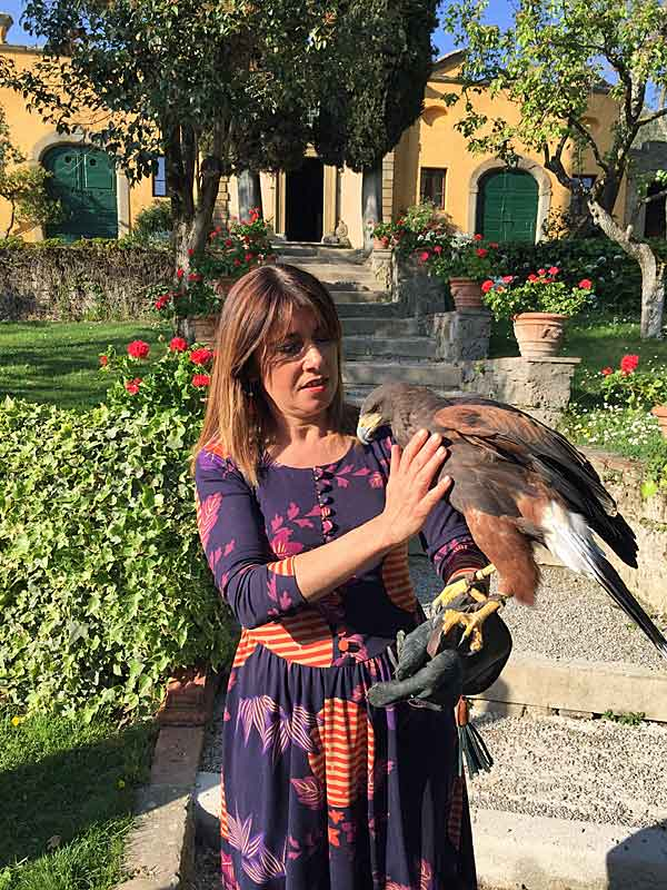 "Head Chef Silvia Baracchi with the falcon at ""Il Falconiere"" in Cortona, Tuscany."