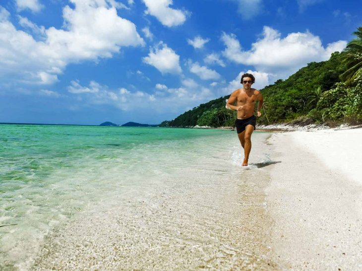 Man running on beach in Koh Samui