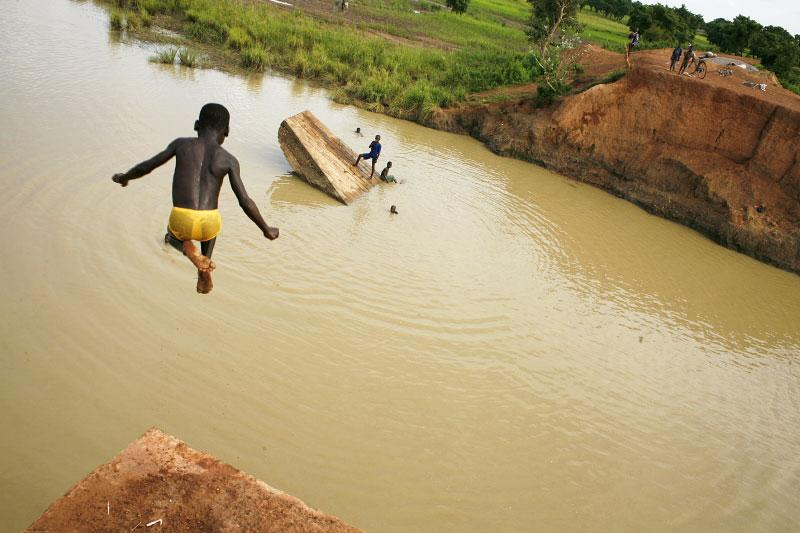 Children use the destroyed Temda Bridge, which collapsed on August 24th 2007, as a playground in Tepane District- Northeastern Ghana. This bridge, which lies 40km from the border of Burkina Faso.