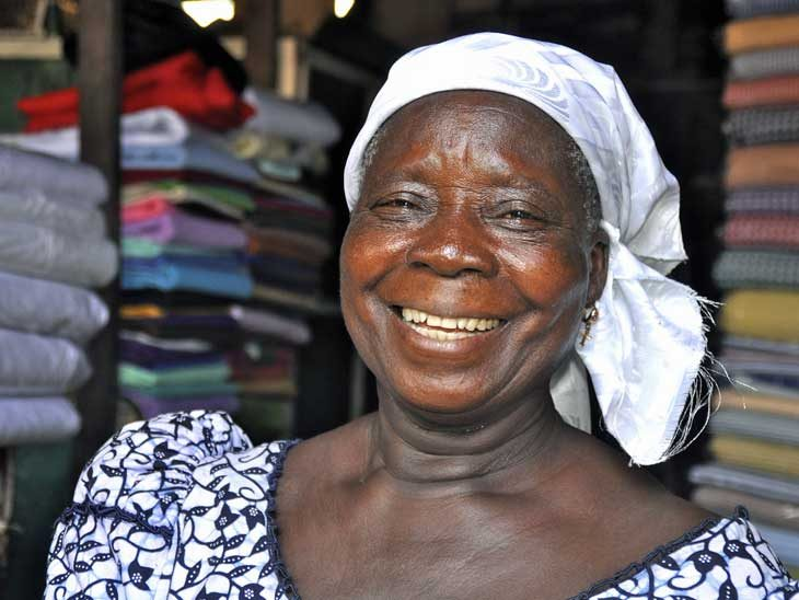 Smiling woman in Ghana.