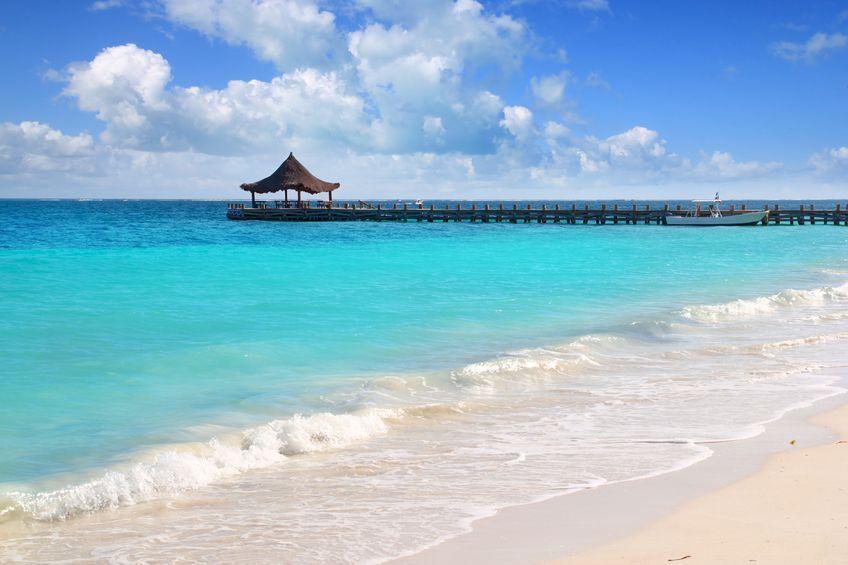 Caribbean sea truquoise beach pier hut Mayan Riviera Puerto Morelos Mexico
