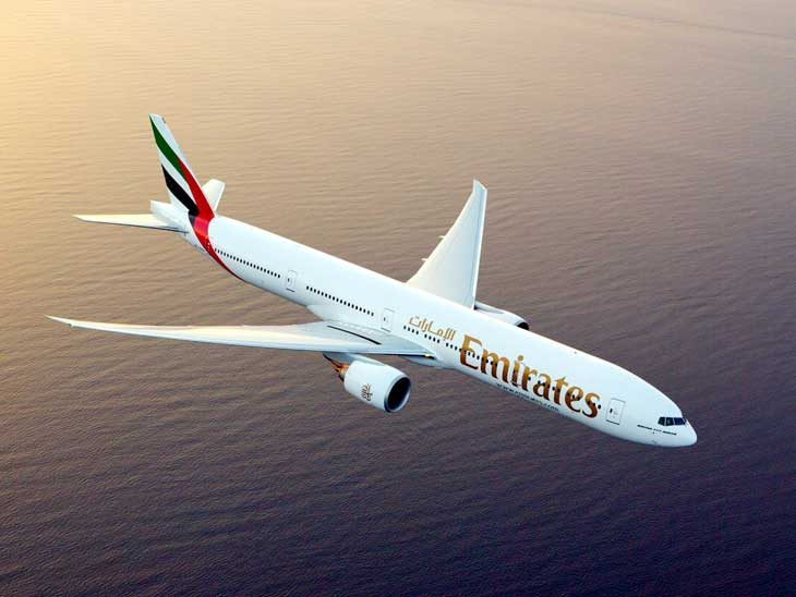 Emirates Boeing 777-300ER in the air.