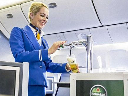 KLM hostess tapping beer in the air.
