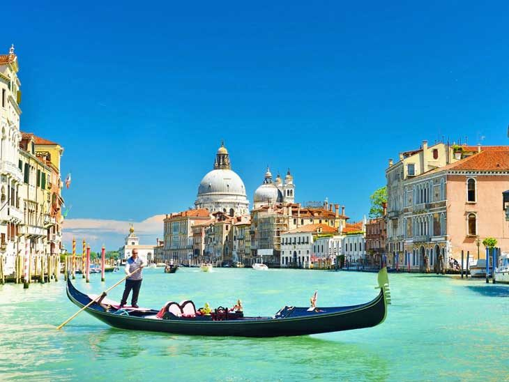 Gondola on the canals of Venice.