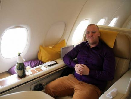 Simon relaxing with a glass of champagne.