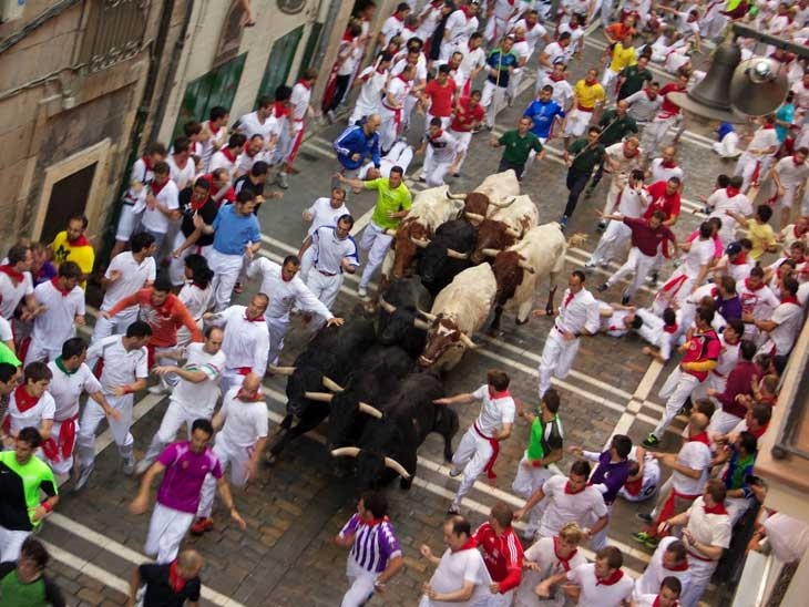The Bull Running in Pamplona, Spain.