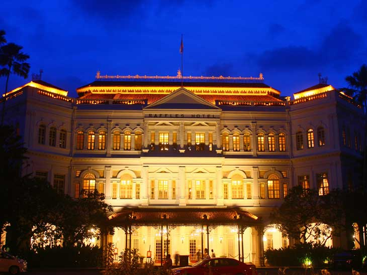The iconic Raffles Hotel at night.
