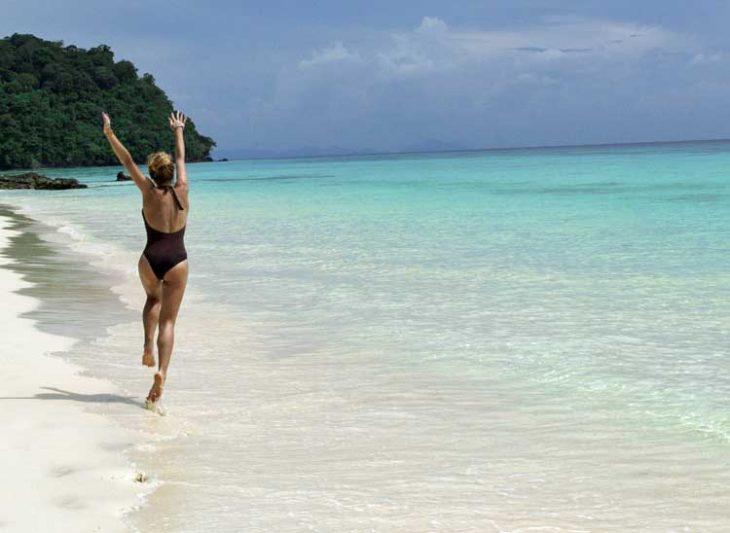Happy girl on sunny beach.