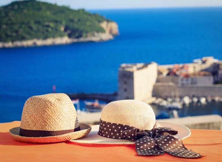 his and her hat with a view