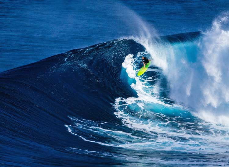 Surfer riding big wave.