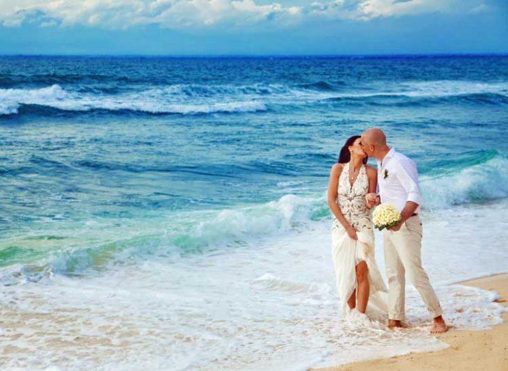 Couple kissing on the beach.